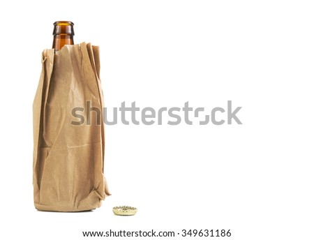 Beer bottle in a brown paper bage isolated with copy space right - stock photo