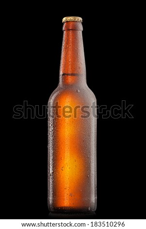 Beer bottle with water drops and frost isolated on black - stock photo