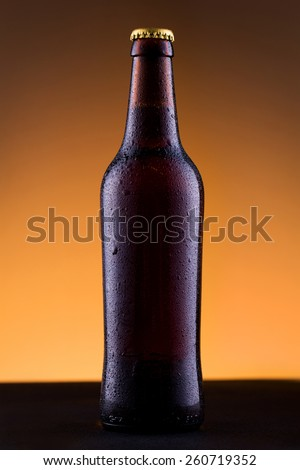 Beer bottle with water drops on background. - stock photo
