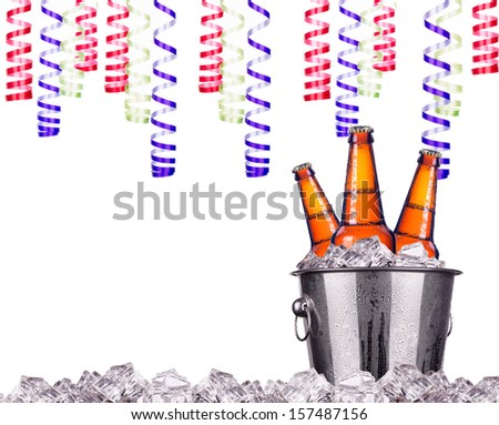 Beer bottles in ice bucket - holiday concept - stock photo