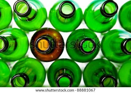 Beer bottles of green glass and a brown. Can be used as background - stock photo