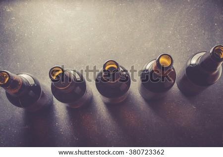 Beer bottles on dark table - stock photo