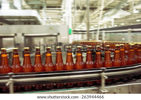 Beer bottles on the conveyor belt  - stock photo