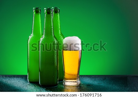Beer bottles with glass against vivid background