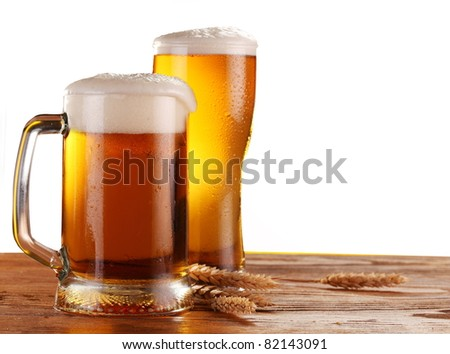 Beer by the glass on a white background.