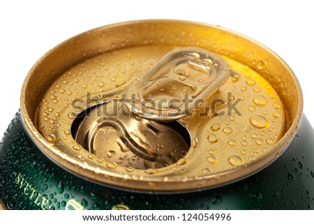 Beer can with drops on white background - stock photo