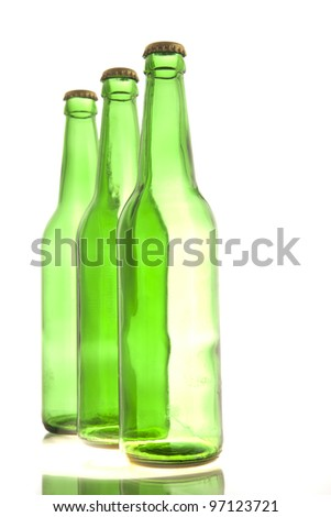 Beer collection - Three green beer bottles. Isolated on white background