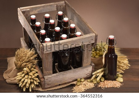 beer crate and beer bottle with hops, wheat, grain, barley and malt - stock photo