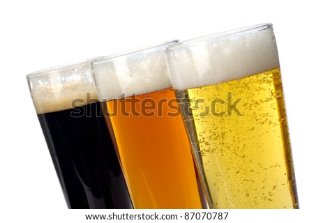 Beer decisions.  Colorful assortment of three beers shot on a white background. - stock photo
