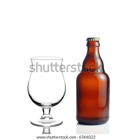 Beer glass and a beer bottle isolated against white background - stock photo