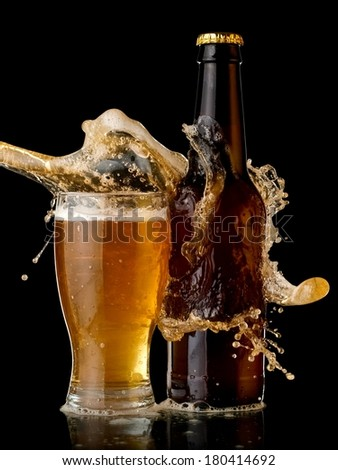 Beer glass and bottle splash