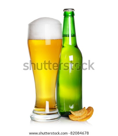 beer glass and bottle with chips - stock photo