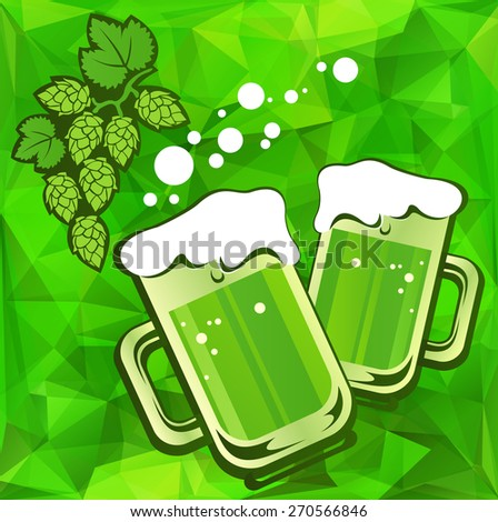 Beer glass and hop on a green background. - stock photo