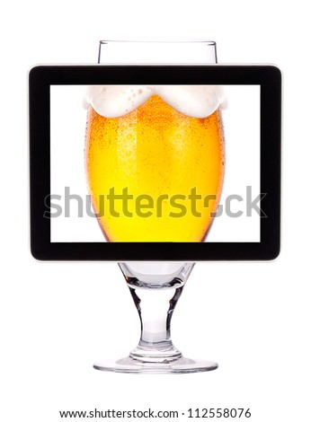 beer glass on tablet computer screen  isolated on a white background - stock photo