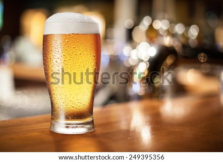 Beer glass on the bar counter. - stock photo