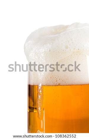 Beer in a glass over white - stock photo