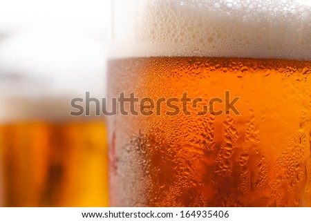 Beer in glass (second version - more natural colors) - stock photo