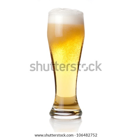 Beer into glass isolated on white - stock photo