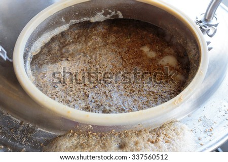 Beer mash in a mashing machine used for all grain commercial beer making. - stock photo