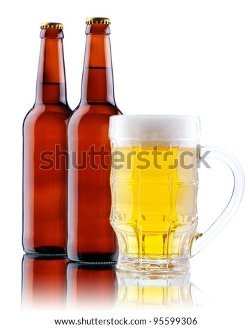 Beer mug and bottle isolated on white background, studio photo