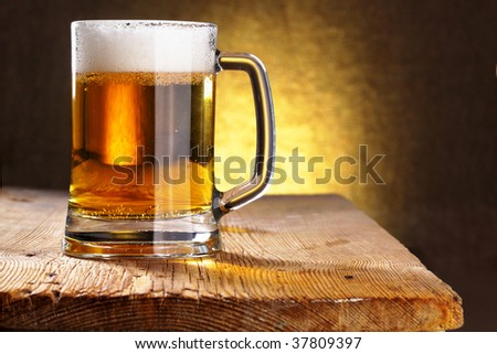 Beer mug close-up on the wood table - stock photo