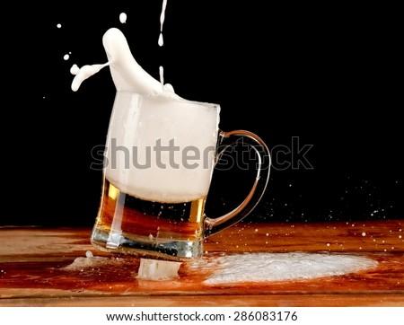 Beer mug jump - stock photo