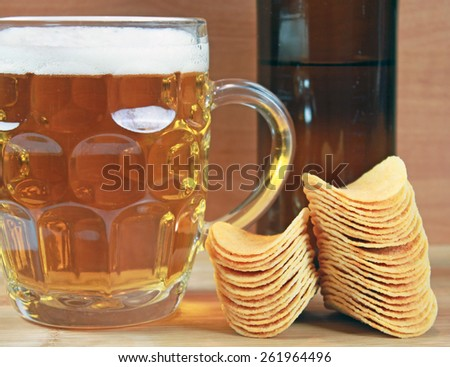 Beer of beer and chips - stock photo