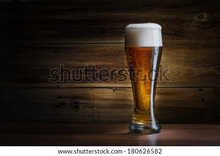 beer on background wooden wall - stock photo