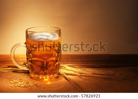beer on sacking with wheat still-life - stock photo