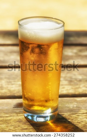 beer over the wooden table - stock photo
