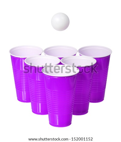 Beer pong. Purple plastic cups and ping pong ball isolated on white background - stock photo