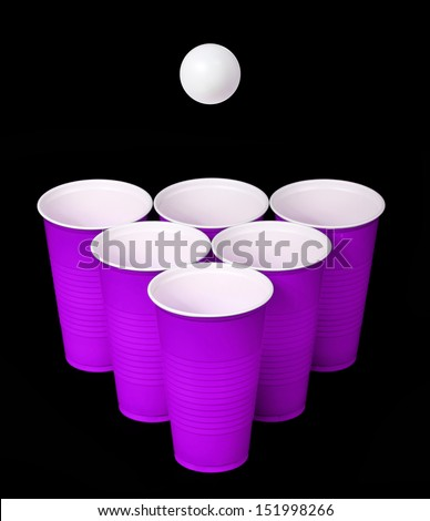 Beer pong. Purple plastic cups and ping pong ball over black background - stock photo