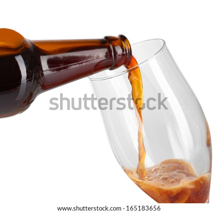 Beer poured into glass isolated on white - stock photo