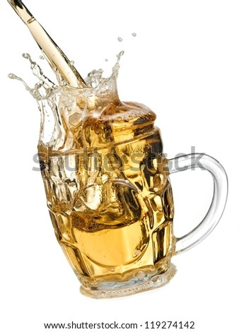 Beer pouring and splash in a mug
