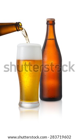 Beer pouring into glass on a white background