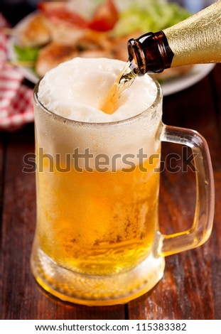 Beer pouring into mug - stock photo