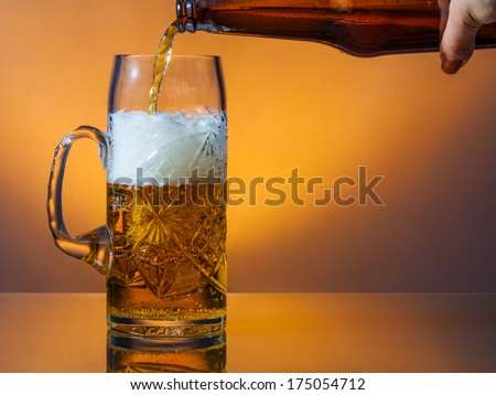 Beer pouring into mug