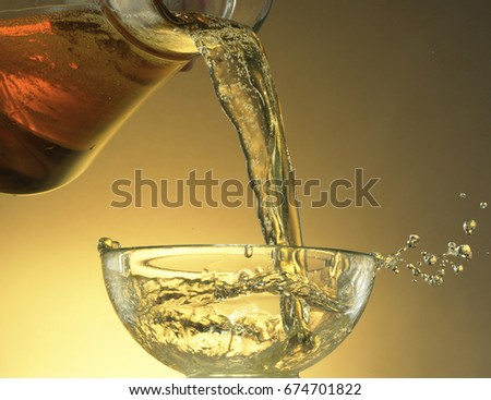 beer pouring on nice golden background