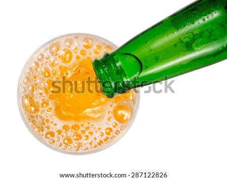 Beer pouring, top view - stock photo
