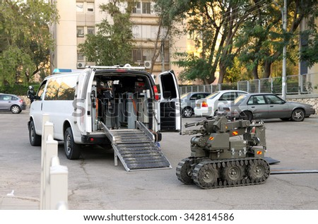 BEER SHEVA, ISRAEL - NOVEMBER 18, 2012:  Military or police robot used to safely move or detonate bombs and mines enters a vehicle for transportation