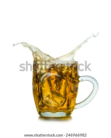 Beer splashing in glass isolated on white - stock photo