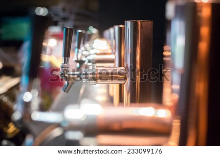 Beer tap in a row - stock photo