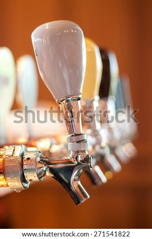 Beer tap in a row - fine belgium brewery in restaurant - stock photo