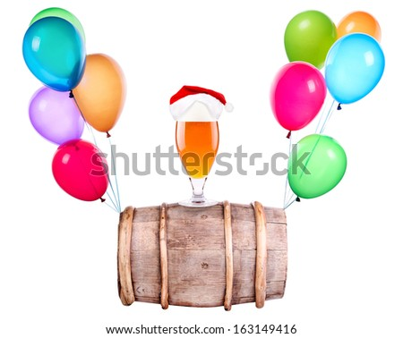 Beer with hat of Santa and flying balloons isolated on white - stock photo