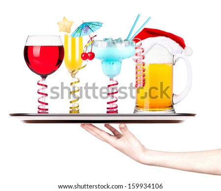 Beer with hat of Santa Claus and cocktail on a silver waitress tray - stock photo