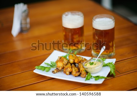 beer with meal on the table