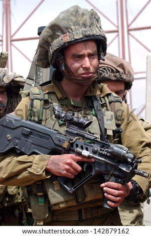 BEERI, ISR - APR 16:Israeli soldiers near Gaza strip on April 16, 2008.The IDF is one of Israeli society's most prominent institutions, influencing the country's economy, culture and political scene. - stock photo