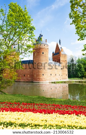 Beersel Castle, Brussels near river with flowers  - stock photo