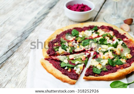 beet hummus spinach goat cheese pizza. the toning. selective focus - stock photo