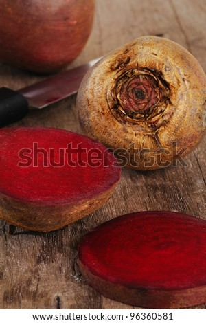 beet roots on wooden background - stock photo